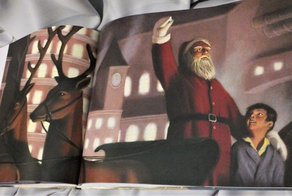 """Pierwszy świąteczny prezent. Strona z książki """"Ekspres polarny"""""""